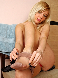 Gorgeous blonde gets ready for a date fitting on her grey control top hose pictures at sgirls.net