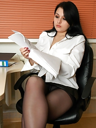 Leggy office girl finds a run and changes into new barely black pantyhose pictures at lingerie-mania.com