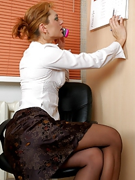 Upskirt office girl pushes down her classy black tights for some dildo fun pictures at freekiloporn.com
