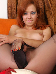 Heated redhead flashes her rear in patterned black hose before dildo toying pictures at adspics.com