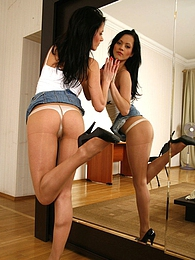 Upskirt teaser posing by the mirror in her denim and control top pantyhose pictures