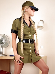 Military babe wearing control top hose under her uniform with no panties pictures at freekiloclips.com
