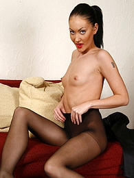 Dolled-up brunette wearing her black control top pantyhose with no panties pictures at freekilomovies.com