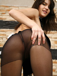 Leggy French maid cleans a room flashing her ass in black control top hose pictures