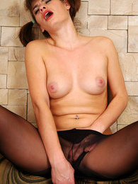 Ponytailed cutie in dark control top hose lights a cig and stuffs her pussy pictures at find-best-mature.com