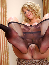 Extremely sexy chick changing her fishnet pantyhose into barely black ones pictures at find-best-mature.com