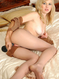 Blondie getting into playful mood stuffing tights under pantyhose waistband pics
