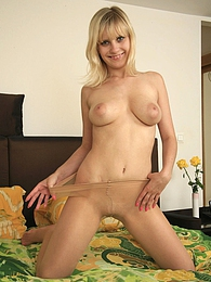 Frisky blonde teasing with upskirt view parting legs in barely there tights pictures at find-best-mature.com