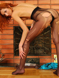 Sassy redhead freaking out utterly ruining her black sheer-to-waist tights pictures at lingerie-mania.com