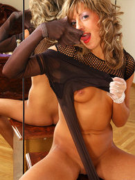 Frisky babe stretching sheer-to-waist hose pulling them on her gloved hands pictures at lingerie-mania.com