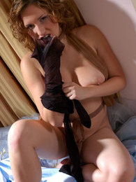 Salacious bride waiting for her groom petting herself with silky pantyhose pictures