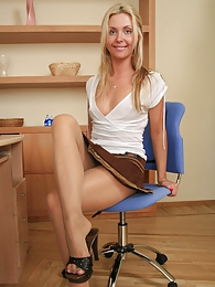 Extremely sexy coed enjoying the feel of sheer pantyhose on her long legs pictures at kilovideos.com