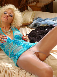 Smashing blondie fitting her glossy grey pantyhose for special occasions pictures at lingerie-mania.com