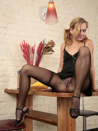Cute office gal in sheer-to-waist pantyhose doing nasty things on the table pictures