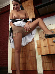 French maid in shiny pantyhose taking time to play hot games on the floor pictures at sgirls.net