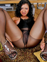 Heated brunette in barely black pantyhose doing nasty things on the floor pictures
