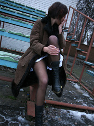 Hottie can't resist her desire to show upskirt with her black pantyhose on pictures at dailyadult.info