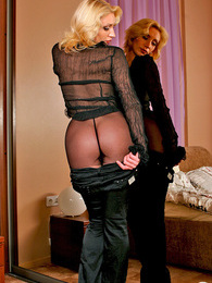 Blondie in black pantyhose exploring her nyloned slit with probing fingers pictures at lingerie-mania.com