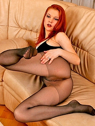 Voluptuous chick worshipping her long legs in silky control top pantyhose pictures at kilotop.com