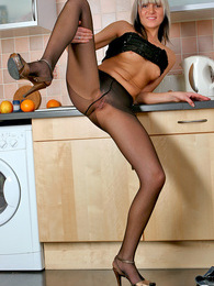 Raunchy babe flashing downtrousers before sliding orange into her pantyhose pictures
