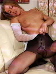 Hottie savoring nice hosiery before sliding hand under pantyhose waistband pictures