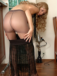 Curvy chick taking time to show her slender legs in control top pantyhose pictures at freekiloclips.com