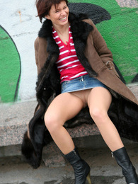 Upskirt chick giving a glimpse of her pantyhose clad pussy right outdoors pictures at dailyadult.info