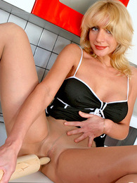 Voluptuous chick in smooth pantyhose slowly stripping off in the kitchen pictures at lingerie-mania.com