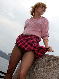 Pretty babe in flying skirt tenderly touching her pussy in smooth pantyhose pictures at kilogirls.com