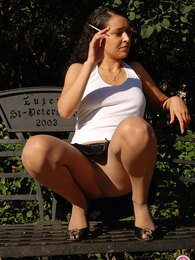 Upskirt chick in sexy pantyhose taking advantage from the stroll outdoors pictures at find-best-panties.com