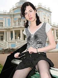 Salacious chick in barely black pantyhose taking time for posing outdoors pictures at kilosex.com