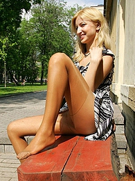 Cutie in tan pantyhose getting the most from flashing upskirt on the bench pictures at lingerie-mania.com