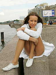 Stunningly beautiful gal teasing with her flying skirt and smooth pantyhose pictures at kilomatures.com