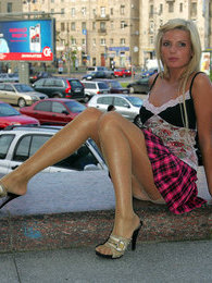 Stunningly beautiful chick in glossy hose spreading her legs right outdoors pictures at adspics.com
