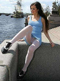 Pretty babe in short gown and white hose getting to upskirt tease in public pictures at freekilomovies.com