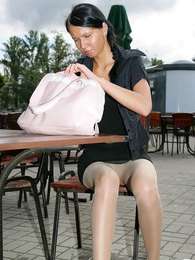 Risky babe in expensive shiny tights boldly flashing butt in a public place pictures at freekilomovies.com