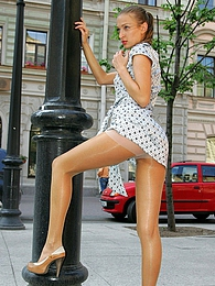 Long-legged girl in satin gown and shiny pantyhose getting to risky upskirt pictures at kilopics.net