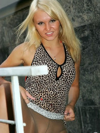 Blonde eye candy encased in shiny suntan hose boldly flashing in public pictures at kilopics.net