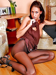 Foxy gal showing off long legs encased in sheer black pantyhose and sandals pictures at find-best-lesbians.com