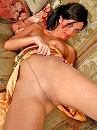 Naughty chick in smooth pantyhose fingering her beaver in every which way pictures at freekilomovies.com