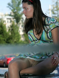Upskirt teaser wearing no panties under her barely visible glossy pantyhose pictures