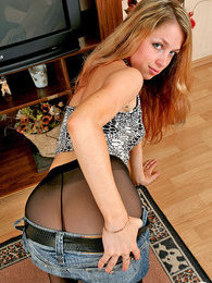 Sexy chick in barely black hose demonstrating her assets on all her fours pictures at dailyadult.info