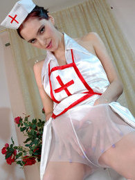 Lewd nurse in white pantyhose dropping on her knees while fingering pussy pictures at sgirls.net