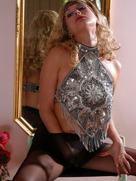 Curly blonde chick in control top pantyhose posing with her legs wide open pictures at lingerie-mania.com