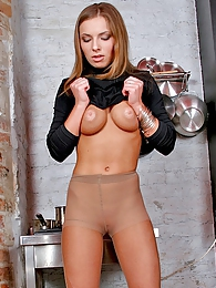 Mischievous chick trying to slide saucepan into her control top pantyhose pictures at lingerie-mania.com
