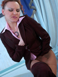 Lusty gal in silky hose stroking herself while putting on her business suit pictures