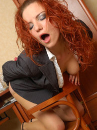Curly secretary in classy tights fulfilling her wet dreams right in office pictures