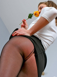 Salacious chick pampering her slender legs under barely black pantyhose pictures at sgirls.net