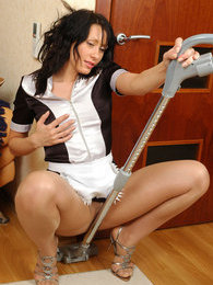 Red hot French maid in smooth pantyhose using vacuum cleaner in weird way pictures