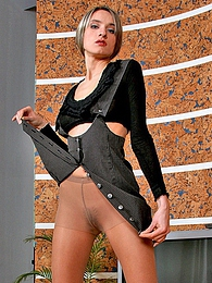 Smashing looking babe in boots and shiny pantyhose can seduce every male pictures at freekiloporn.com